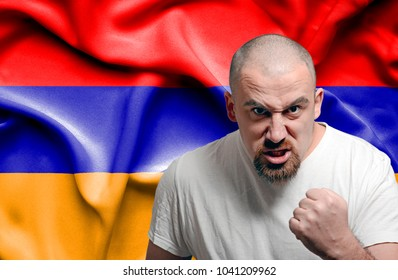 Angry man against flag of Armenia