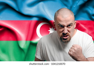 Angry man against flag of Azerbaijan