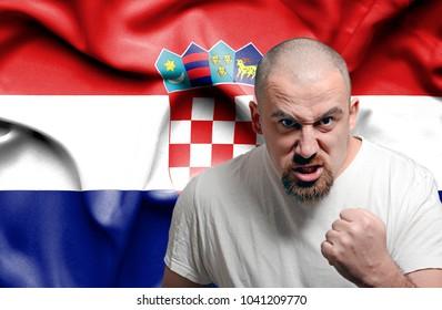 Angry man against flag of Croatia