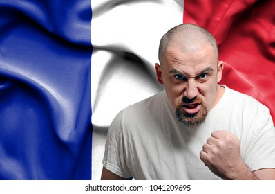 Angry man against flag of France