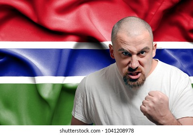 Angry man against flag of Gambia