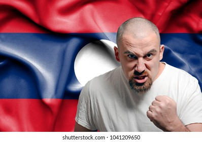 Angry man against flag of Laos