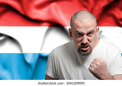 Angry man against flag of Luxembourg