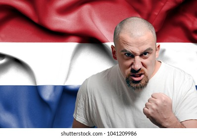 Angry man against flag of Netherlands