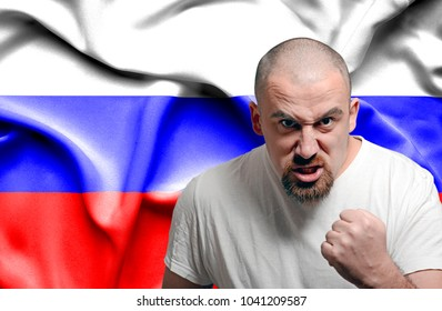 Angry man against flag of Russia