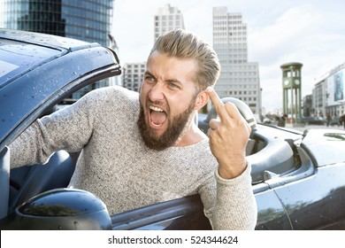 angry man in a car is showing the middle finger