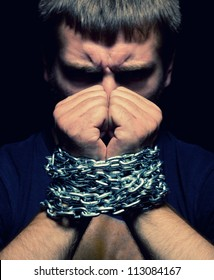 Angry man with chained hands