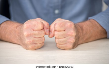 angry man, a  close-up of his fists