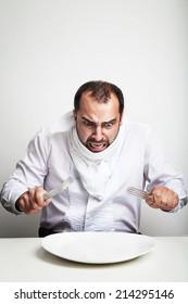 Angry man eating