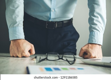 angry man fists in office desk