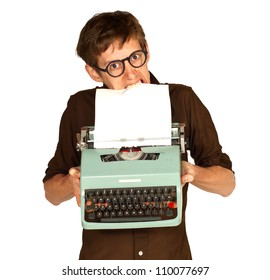 Angry man with glasses pulling a piece of white paper from a vintage typewriter using his teeth, isolated on white background.