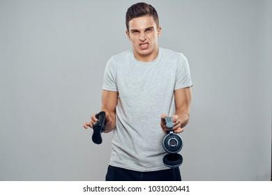 angry man headphones, joystick on a gray background
