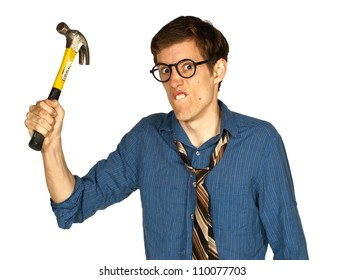 Angry man looking at camera and brandishing a hammer, isolated on white background.