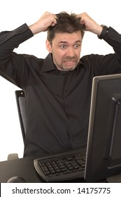 Angry man looking at the computer screen with a look of horror on his face, pulling his hair out. Background is white isolated.