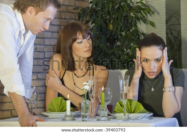 angry man looking at woman in a restaurant