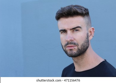 Angry man with piercings and radical haircut