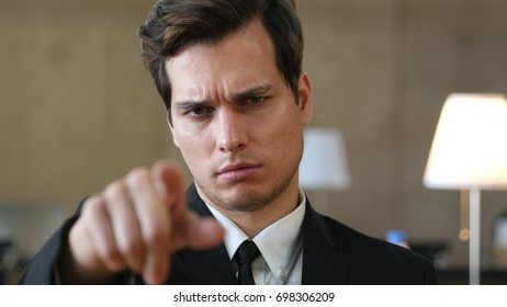 Angry Man Pointing toward Camera with Finger