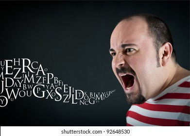 Angry man shouting against black background with letters coming out from his mouth. Conceptual image.
