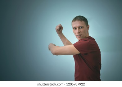 Angry man is swinging by copy space isolated on blue background.