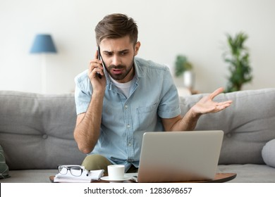 Angry man talking on phone disputing over computer laptop problem, stressed unsatisfied impatient customer arguing by mobile solving online difficulty with technical support complain on bad service
