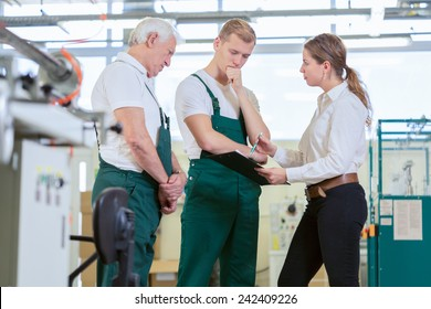 Angry manager controlling employees in manufacturing plant