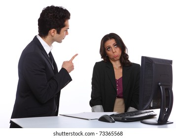 Angry Manager with secretary infront of a computer