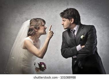 Angry married couple quarreling