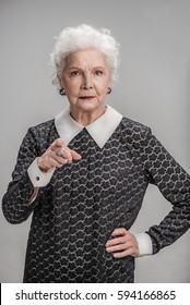 Angry mature woman gesturing seriously