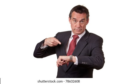 Angry Middle Age Business Man Pointing at Time on Watch