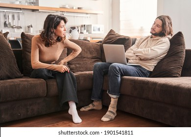 Angry millennial couple arguing, shouting, blaming each other of problem. Frustrated husband and annoyed wife quarreling about bad marriage relationships. Unhappy young family fighting at home concept