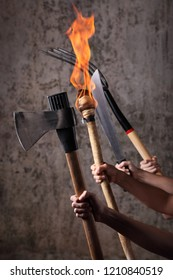 Angry mob holding pitchfors,machetes,axes, and flaming torches