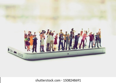 Angry mob of various, diverse people on a phone. Social media addiction concept or people mistreating one another online. Group mentality or cancelled culture. Men and women arguing over politics.