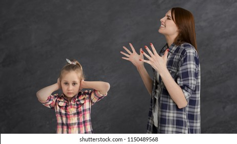 Angry mother punishing little daughter, shouting at her