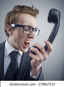 Angry nerd businessman retro telephone call shouting