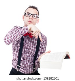 Angry nerd man holding book and pointing, isolated on white background
