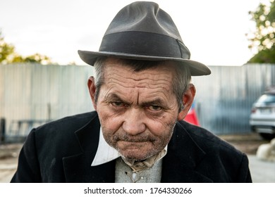 Angry old man with a hat. Anger concept