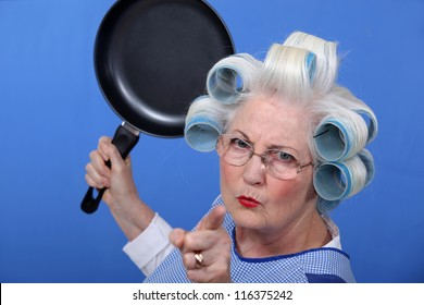 Angry old woman with a frying pan