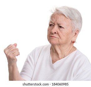Angry old woman making fist on white background