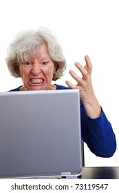 Angry old woman screaming at her laptop