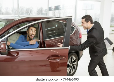 Angry salesman running after his customer driving away on a new car chasing chase stealing cars thief theft illegal runaway transport vehicle automobile automotive furious fast speed concept