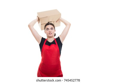 Angry seller girl throwing a cardboard box in your direction isolated on white background