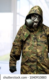 angry soldier wearing a gas mask against an abstract background