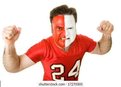 Angry sports fan with a painted face, raising his fists and growling aggressively.