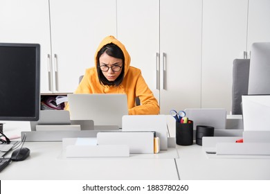 Angry stressed designer woman sitting at workplace, being frustrated and executive, feeling indignant annoyed about having deadline. Stock photo