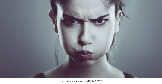 Angry stressed young woman face. Close up of Frustrated Female.