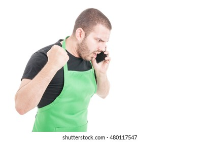 Angry supermarket employee yelling at telephone isolated on white background with copy space area