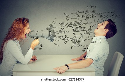 angry teacher woman with megaphone shouting at stressed scared student blown away by wave of science math formulas. Negative human emotions