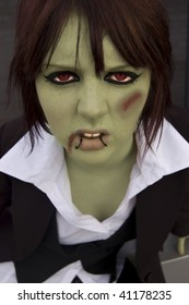 An angry teenage girl with lip piercings has been turned into a zombie at halloween!