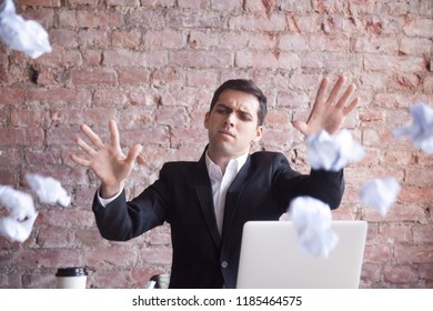 Angry tired businessman Quits job, throws crumpled paper in the air. Stress at work, bad day at workplace. Employee does not like his ideas, No Concentration, Unable to Think, Breakdown concept