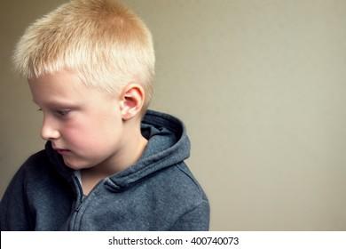 Angry upset sad child (boy, kid) portrait
